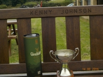 The treasure at the end of the Rainbows. The Memorial Trophy on Kenny's bench with a nice bottle to toast the event.