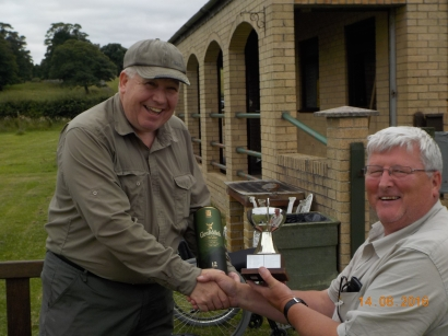 Keith Johnson presents the trophy to Norman Fletcher